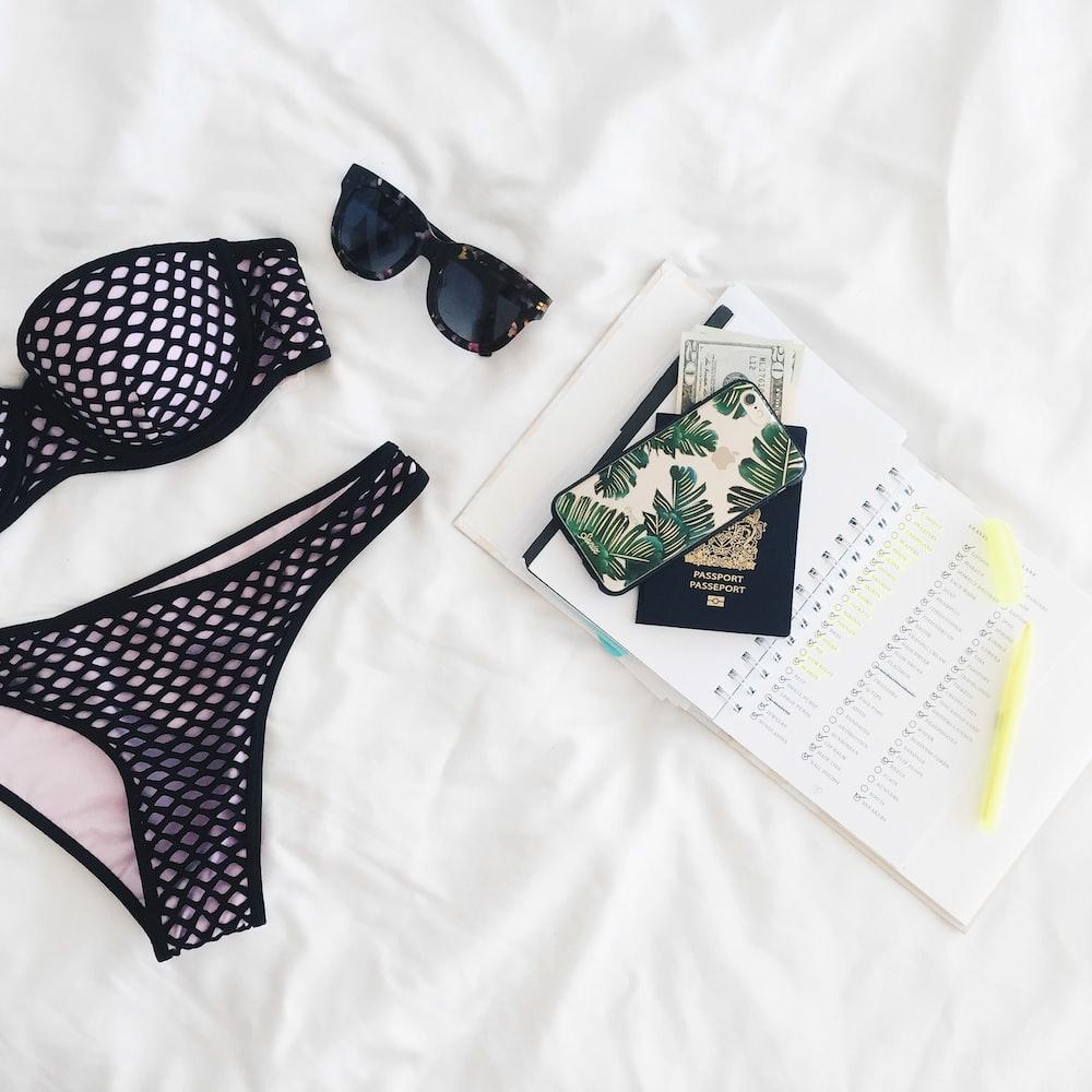 women's black-and-pink bikini on whit textile