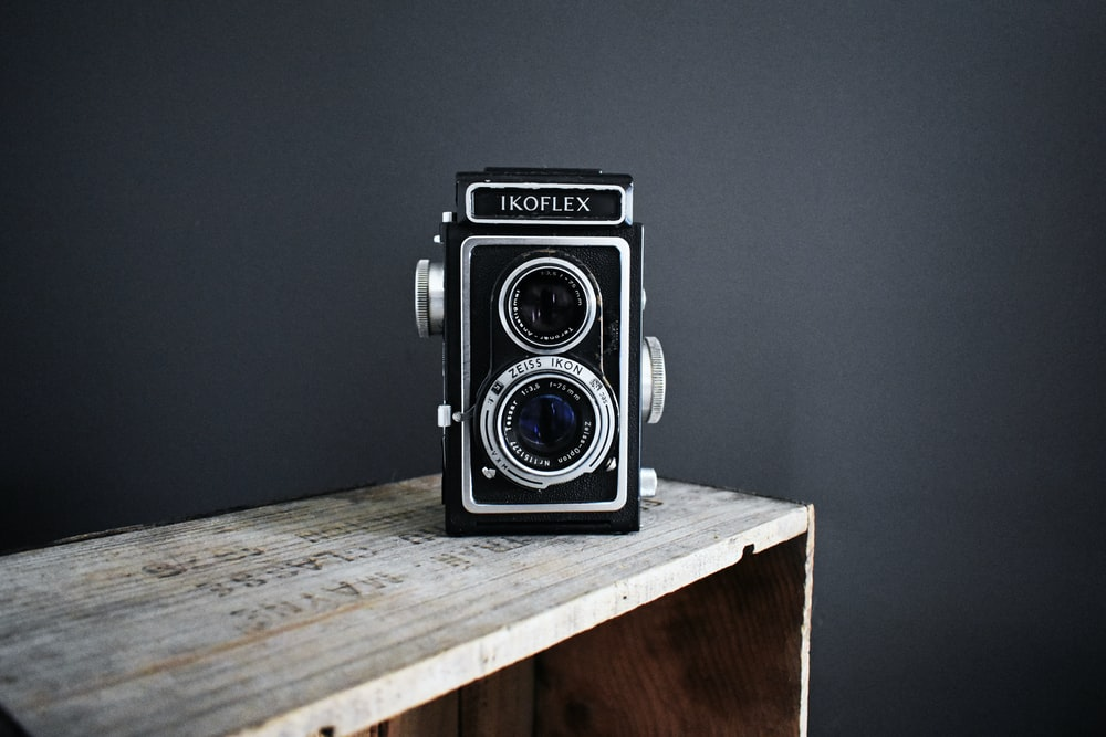 black camera on side table