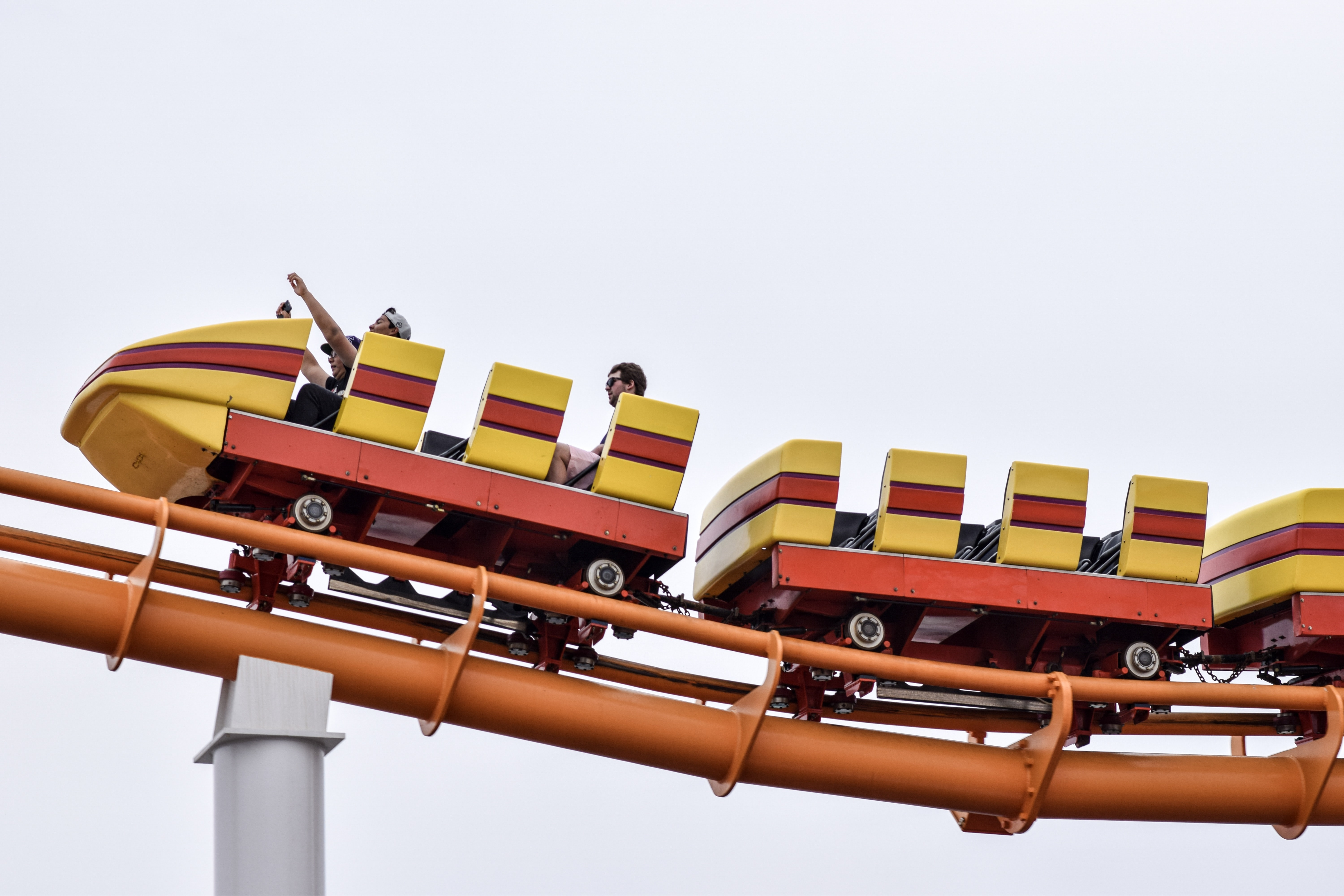 people riding on rollercoaster