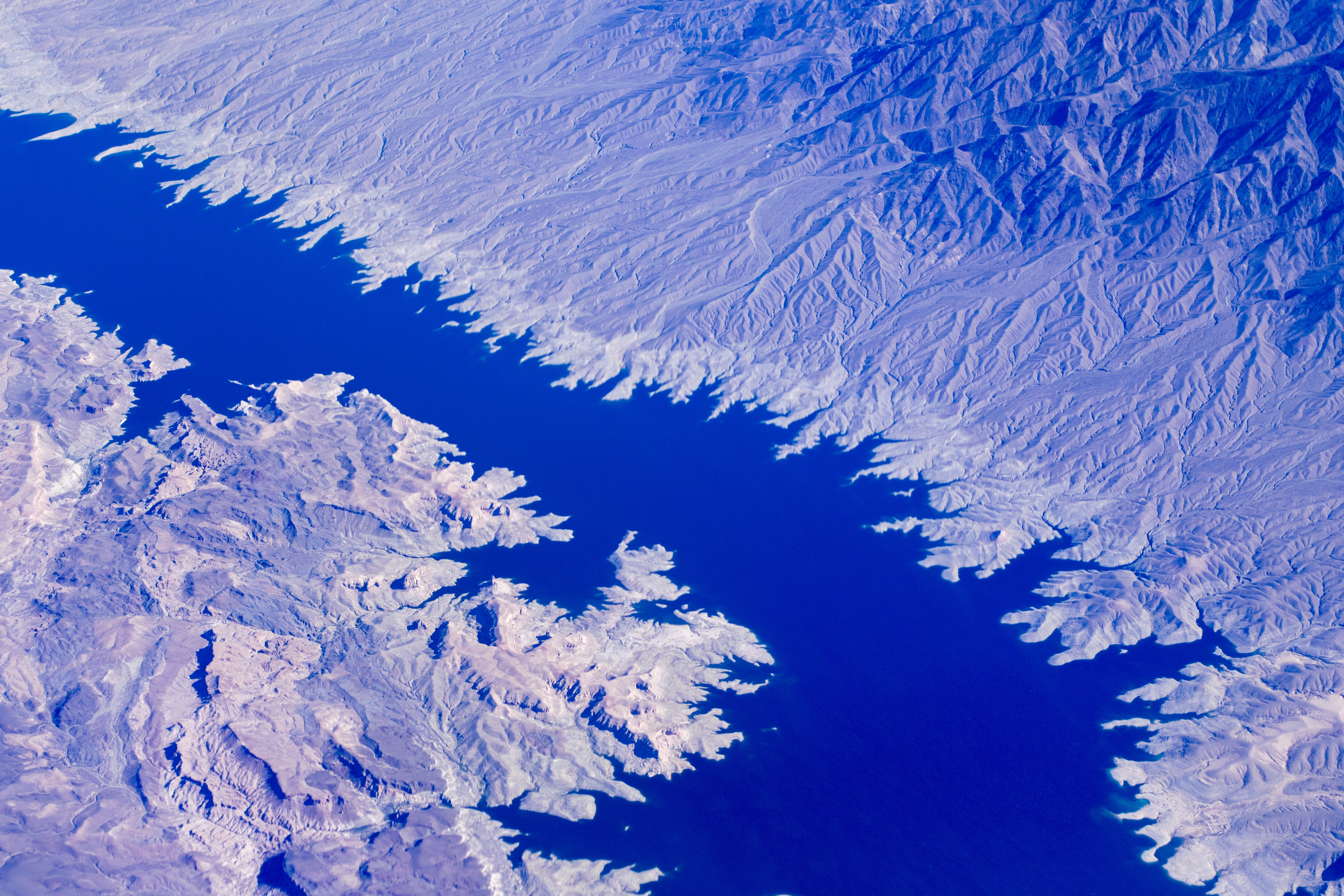 aerial photo of body of water in between mountains