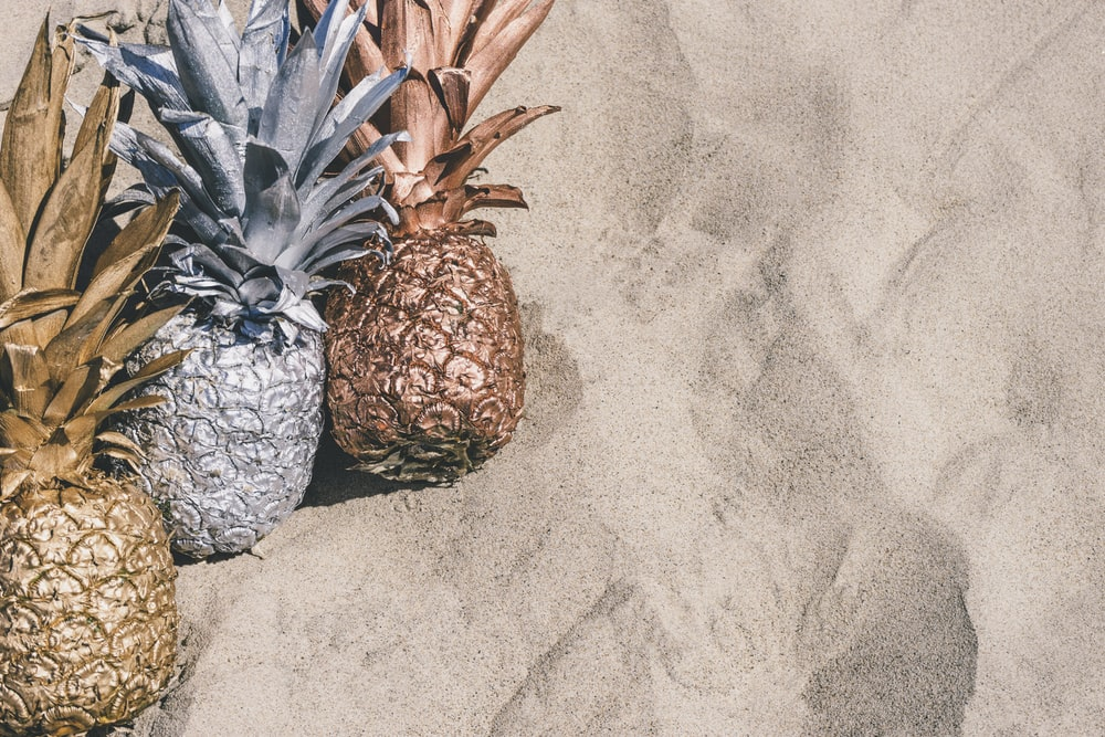 grey and brown pineapple fruit on grey surface