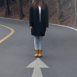 woman standing on asphalt road