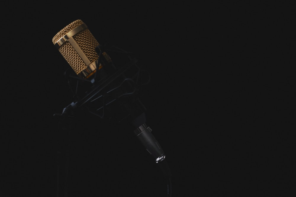 A Professional Microphone Against Black Background