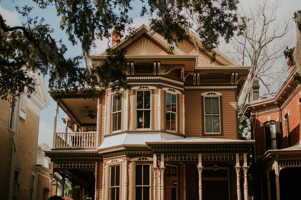 A beautiful house with a porch in a residential neighborhood in the heart of Savannah, Georgia.