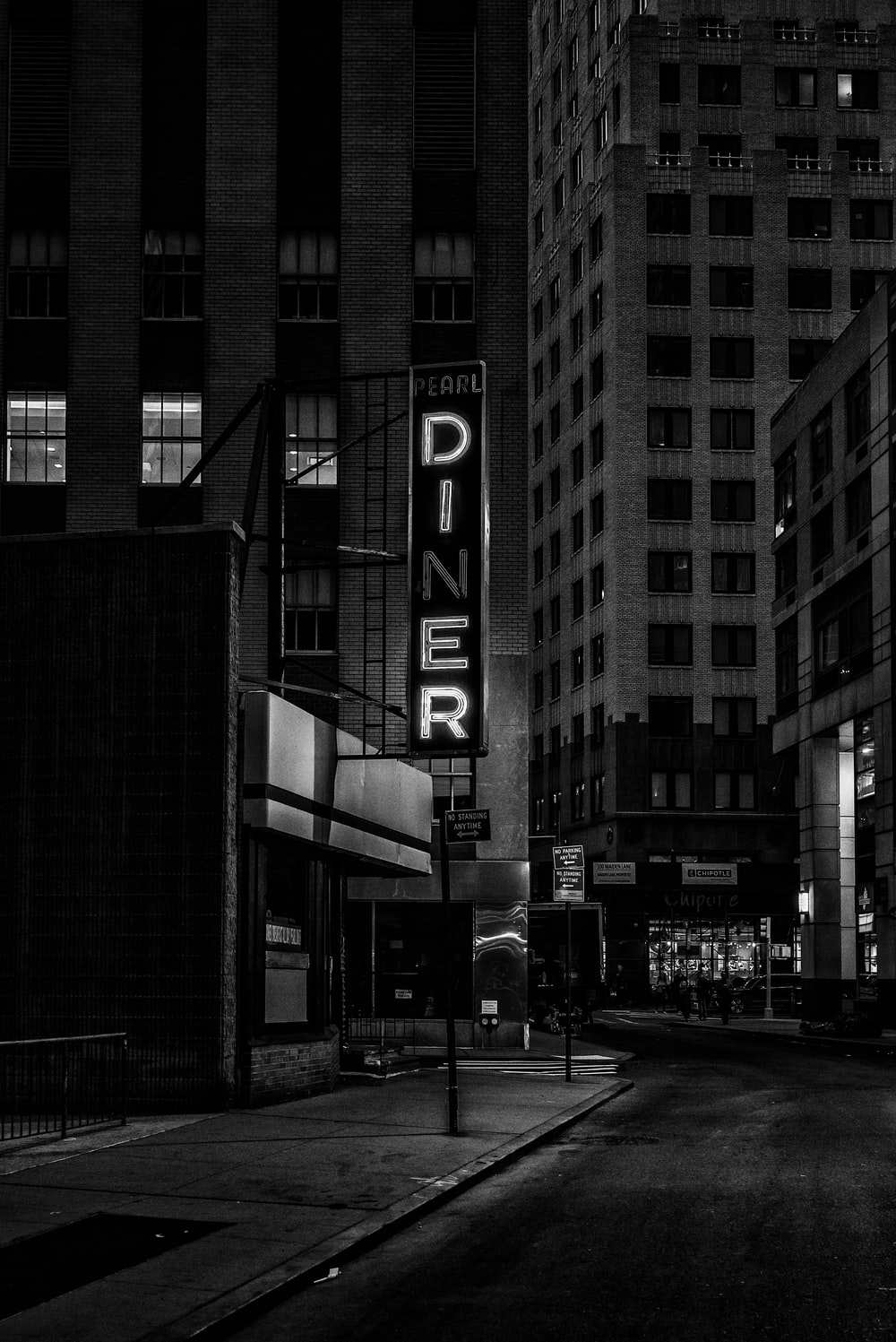 grayscale photo of Pearl Diner sign in city
