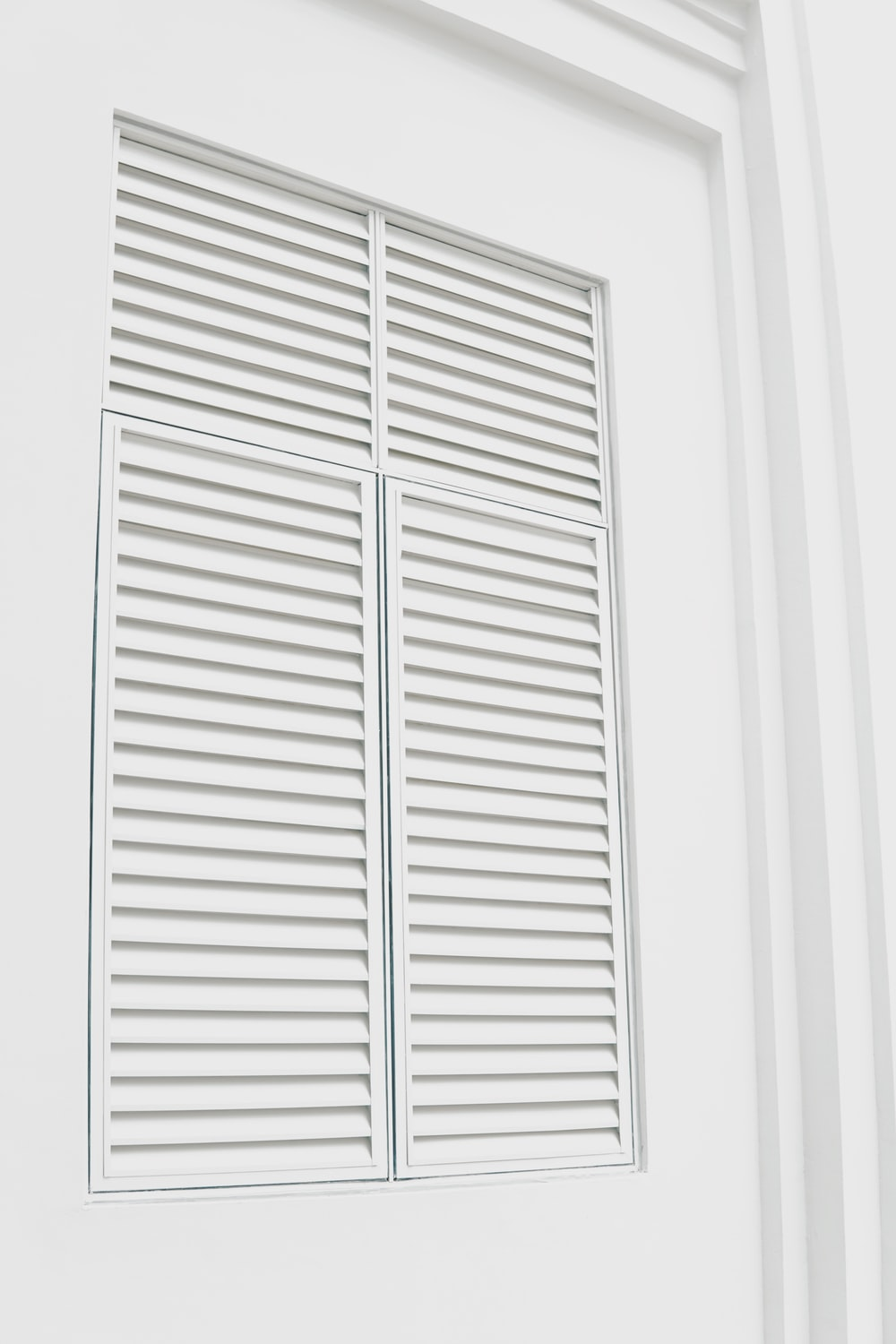 white wooden louvered door