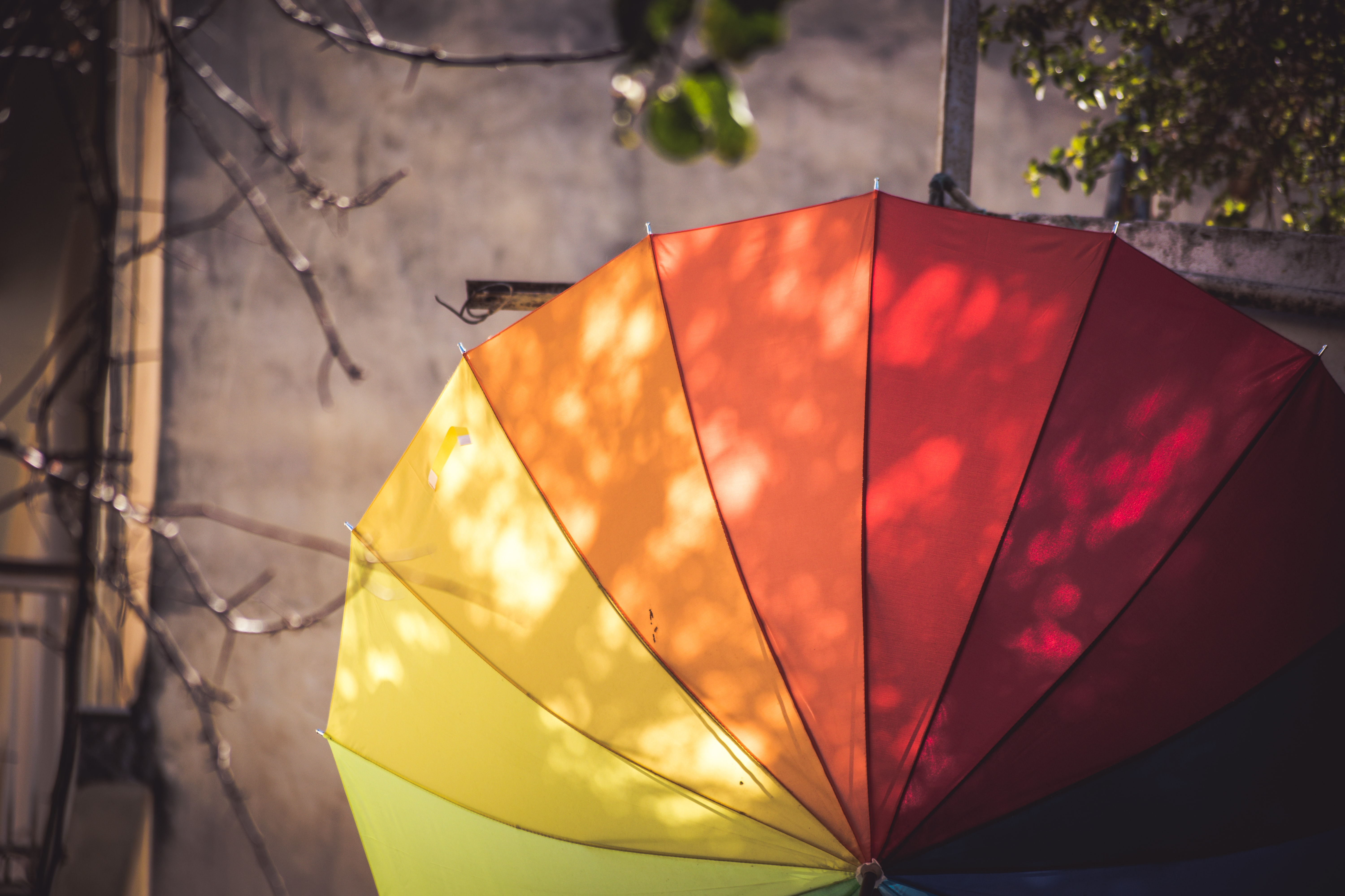 multi-colored umbrella hanged on pole
