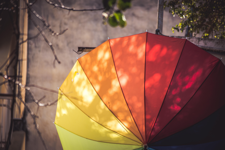 multi-colored umbrella hanged on pole