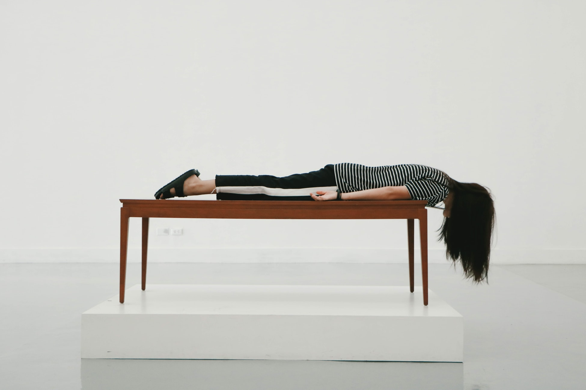 a women lying face down on a table