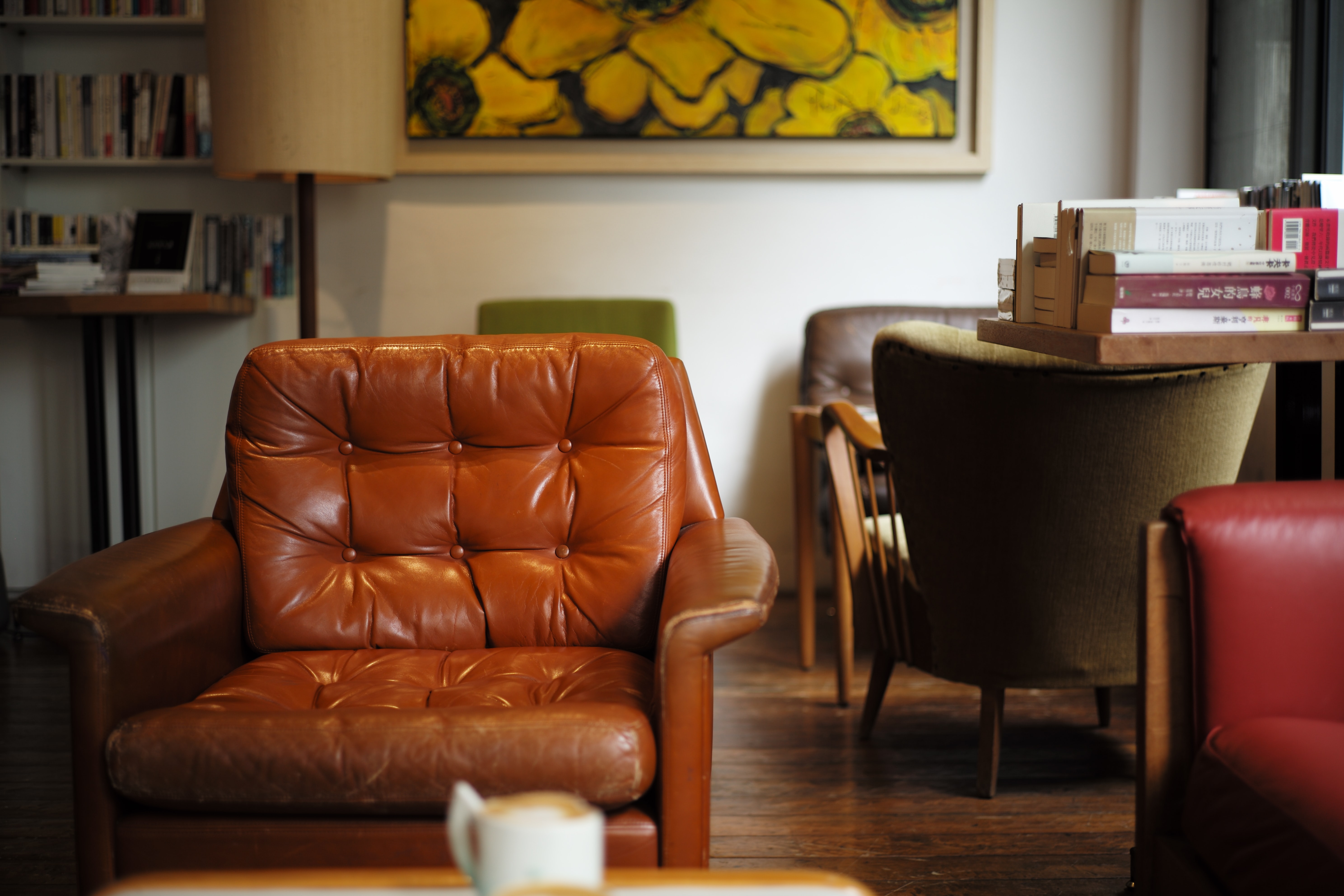 tufted brown leather armchair