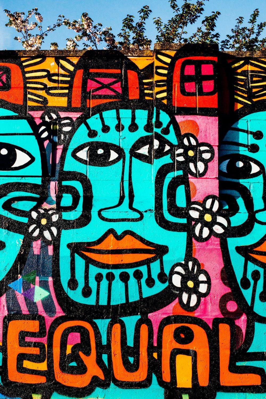 pink, teal, and orange graffiti wall art