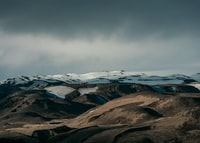 snow capped mountain under dim sky
