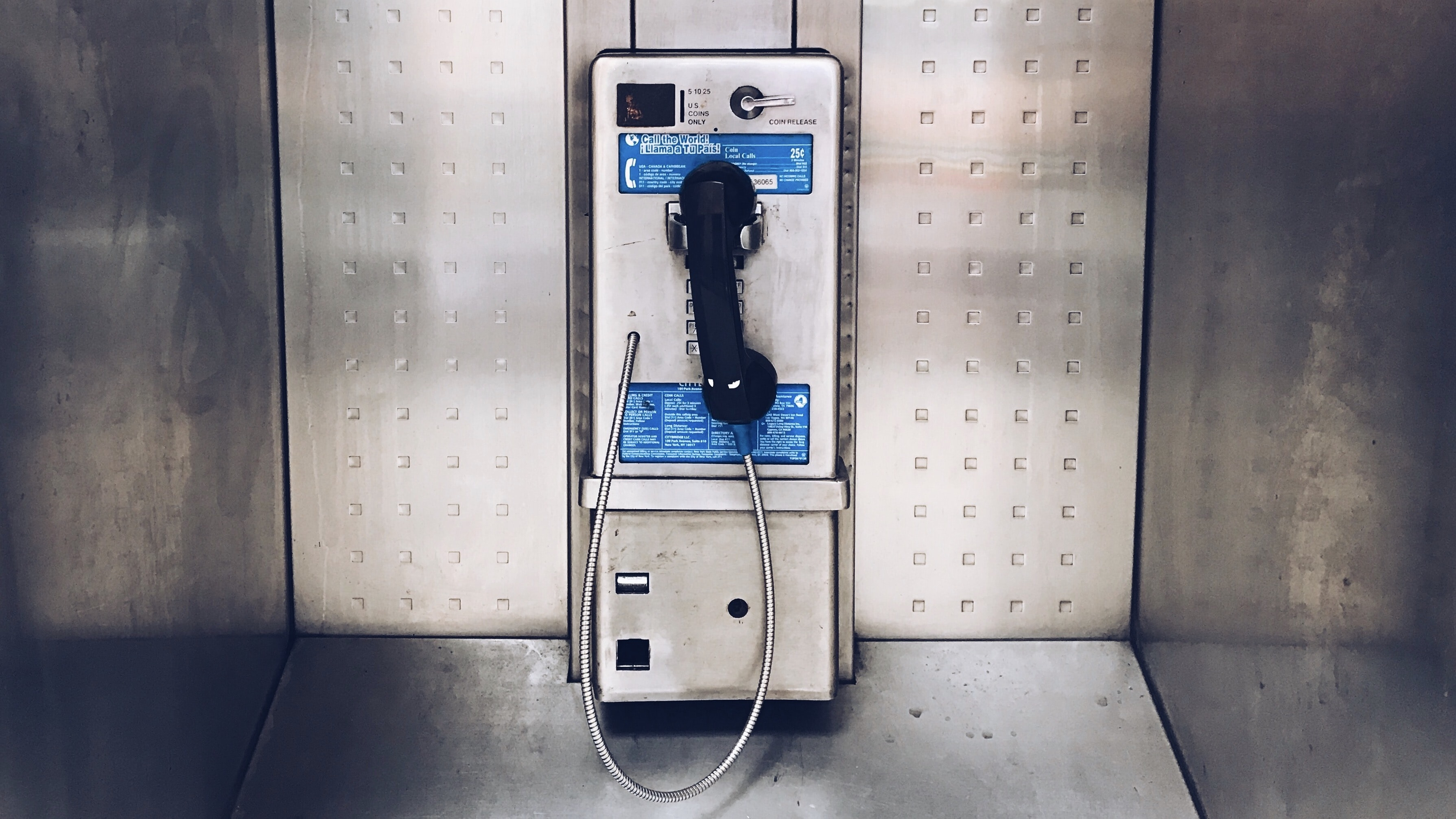 gray payphone close up photography