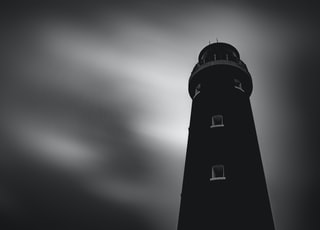 low angle photography of black lighthouse