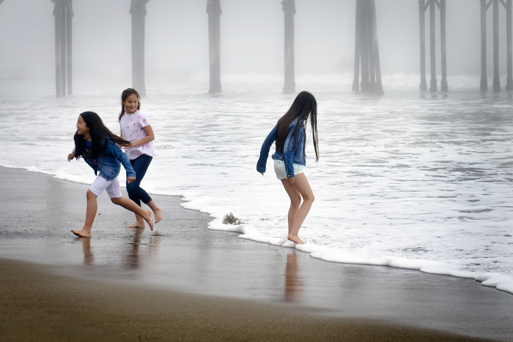 girls playing on shore