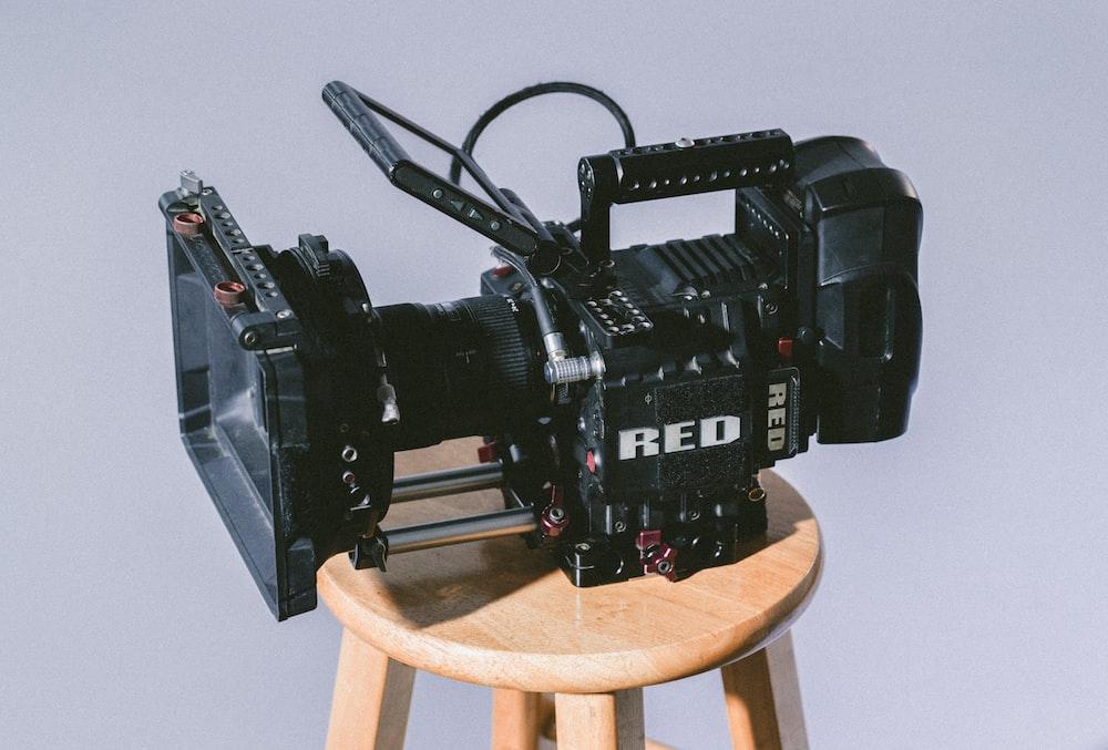 A Black Cinema Camera On Wooden Stool