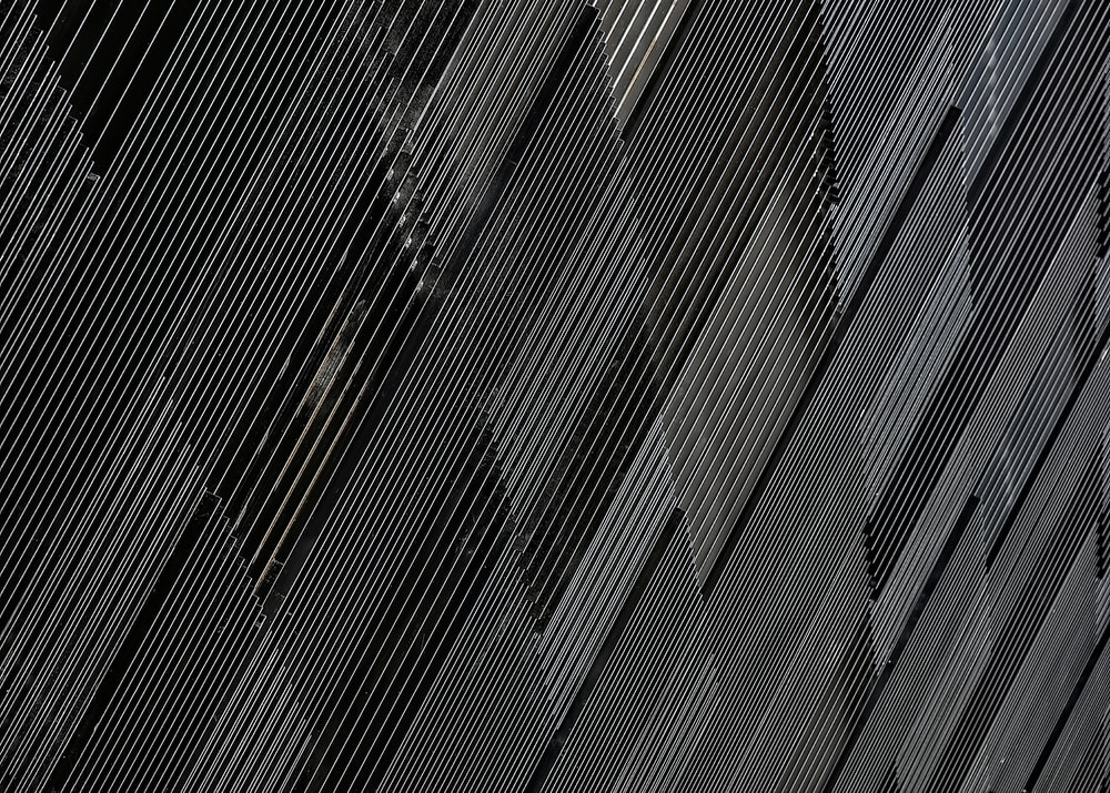 close-up photograph of black concrete wall