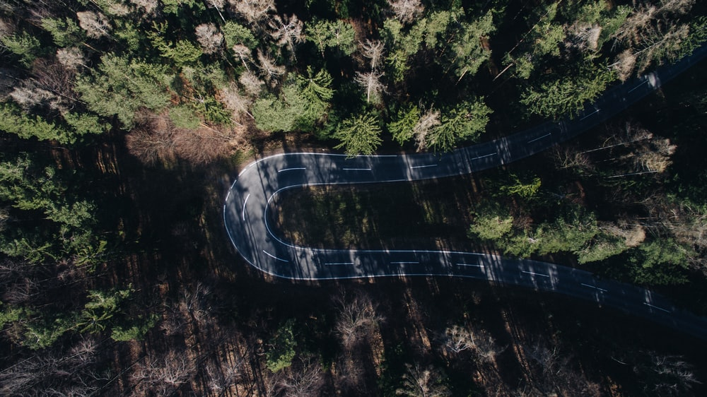 aerial view photography of gray concrete road during daytime