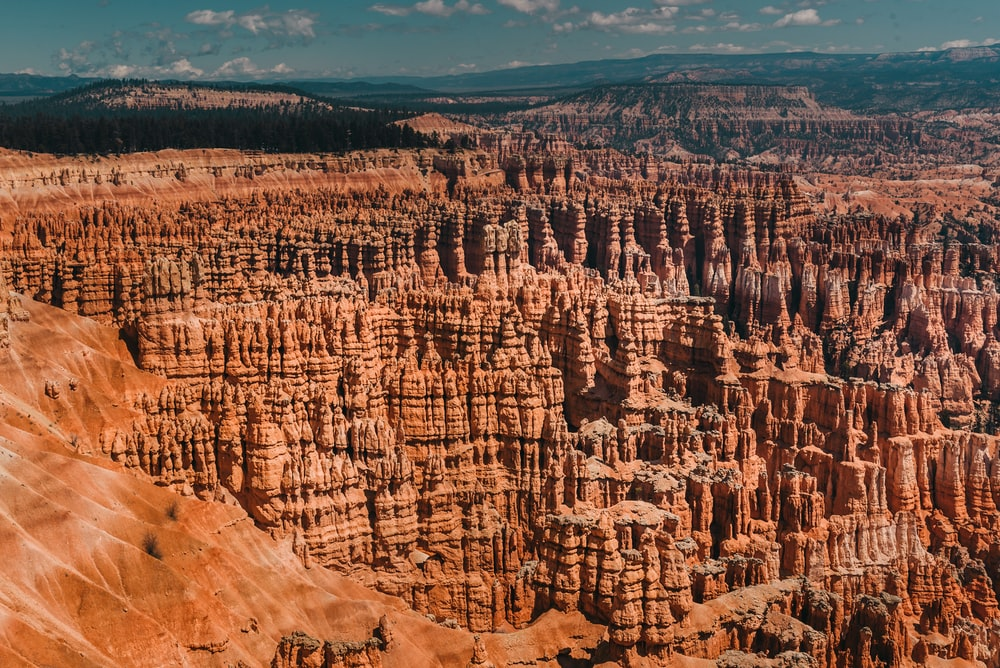 brown rocky mountain in aerial shot