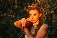 selective focus photography of woman with berry crown on her head