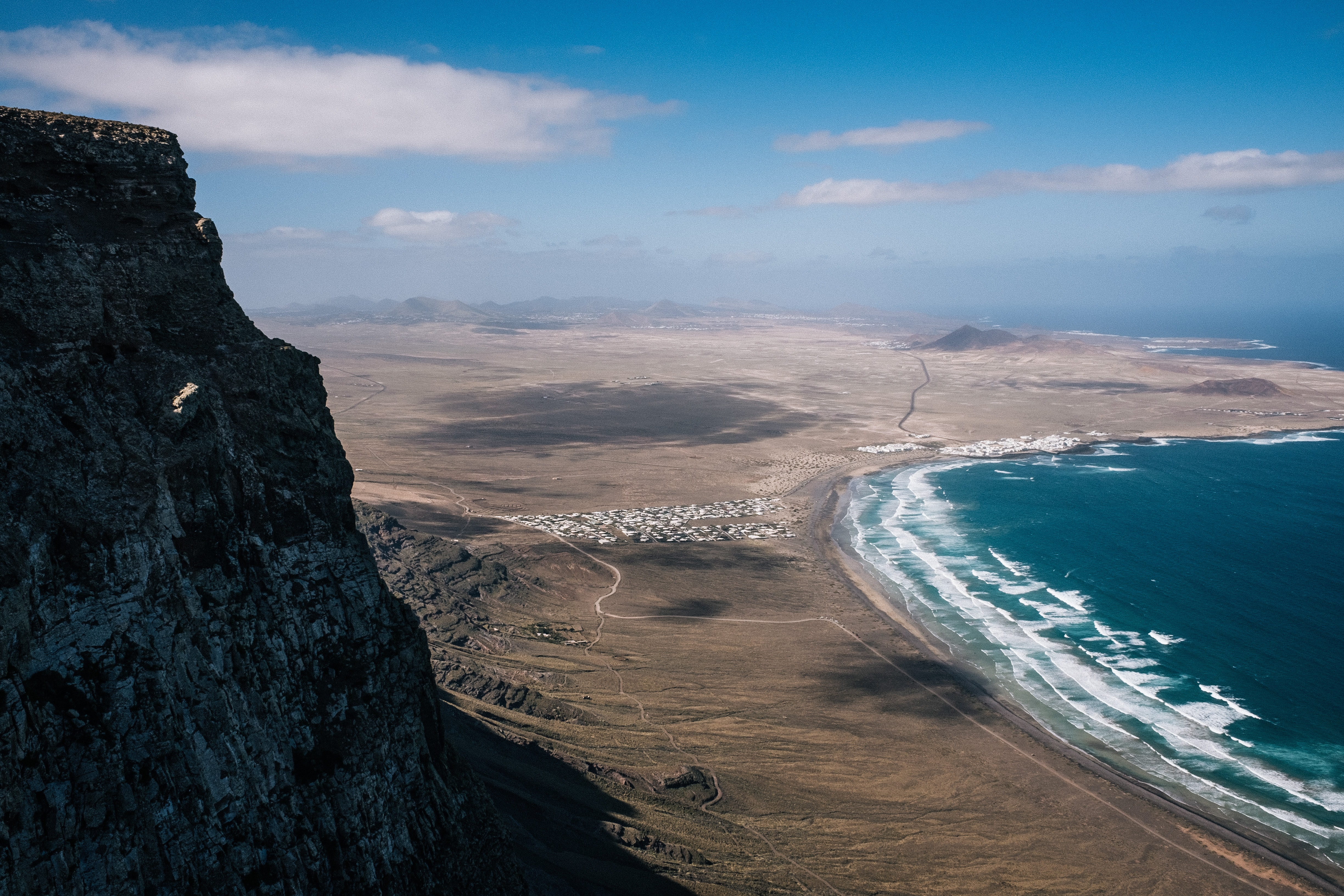 aerial photo of ocean in front mountain