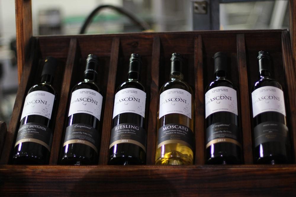 several labeled bottles on rack
