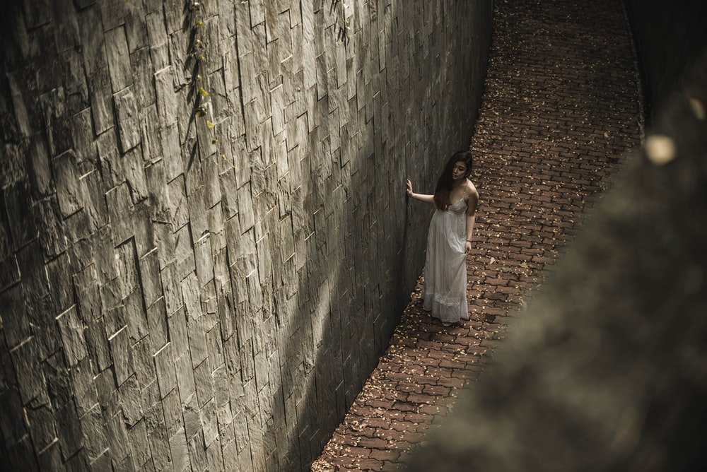 woman standing beside wall