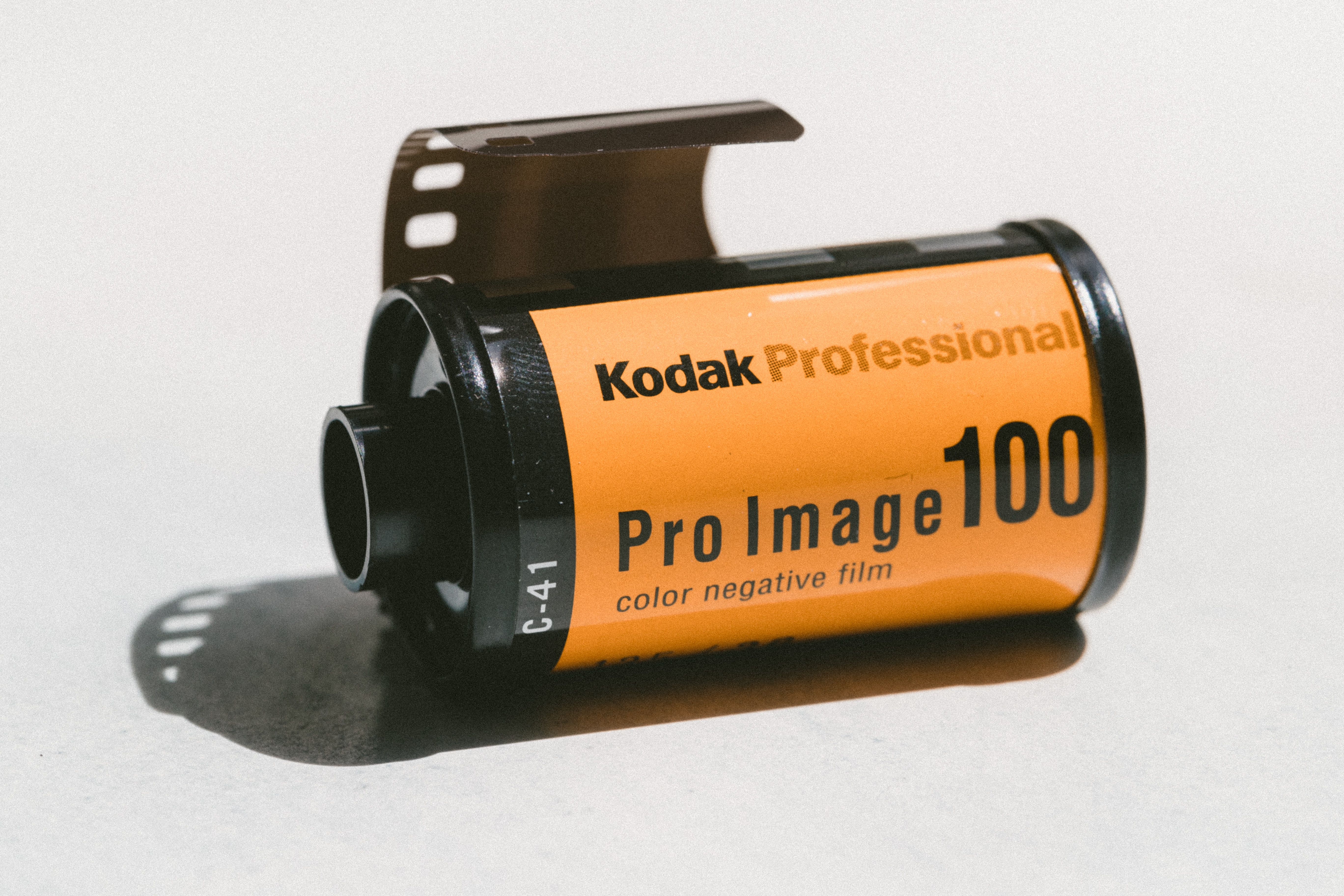 Kodak Professional Pro Image 100 color negative film canister with film peeking out