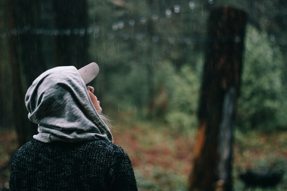person looking at the rain drops