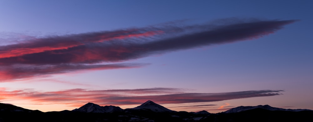 mountain ranges under clouds