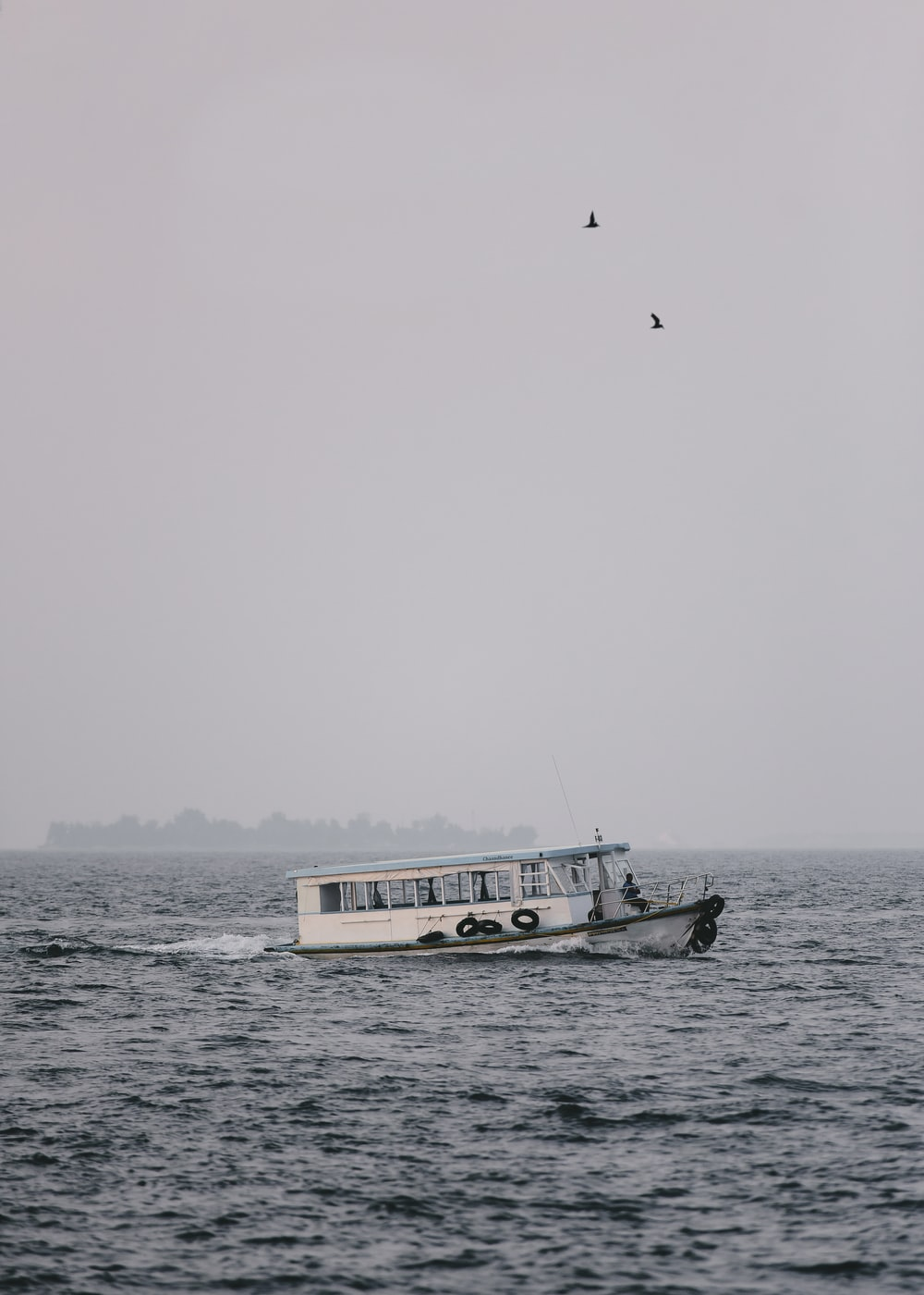 passenger boat during cloudy day