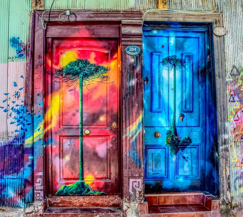 tree printed and multicolored closed doors