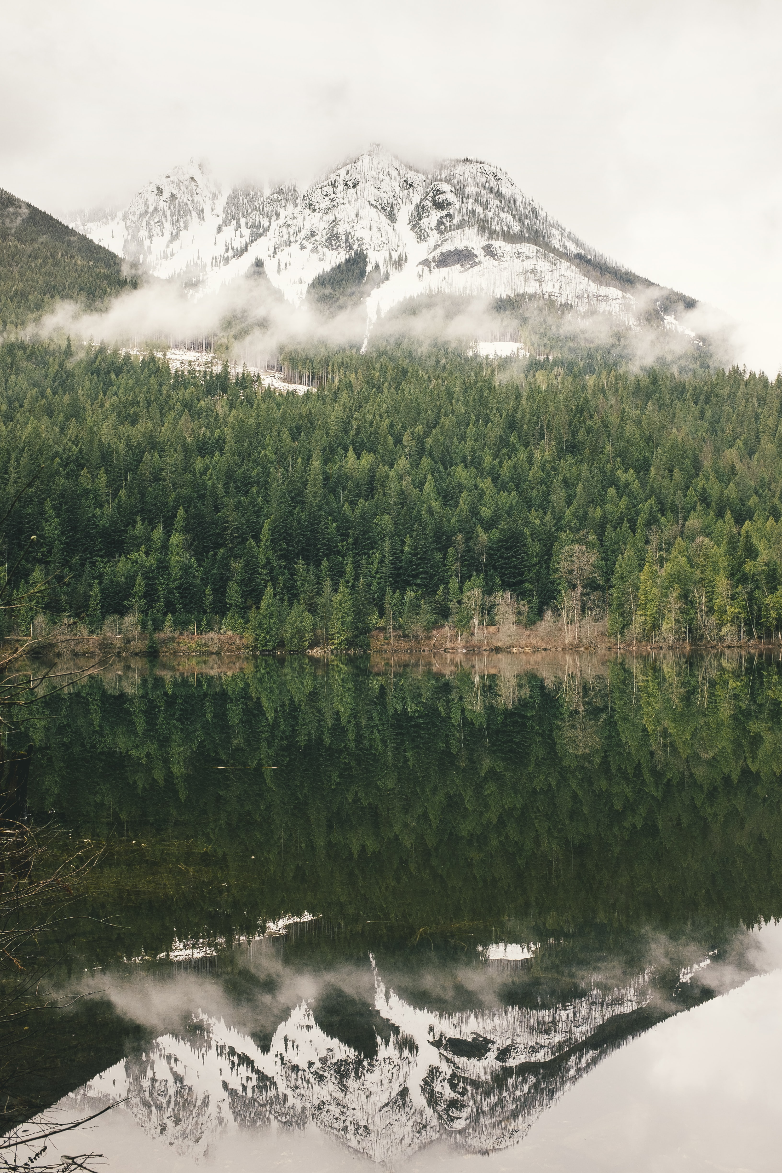 A snow-topped mountain reflected in the surface of a lake