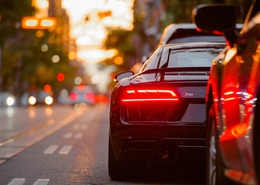 black Audi R8 parked beside road