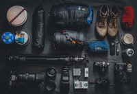 photo of assorted cameras and bags