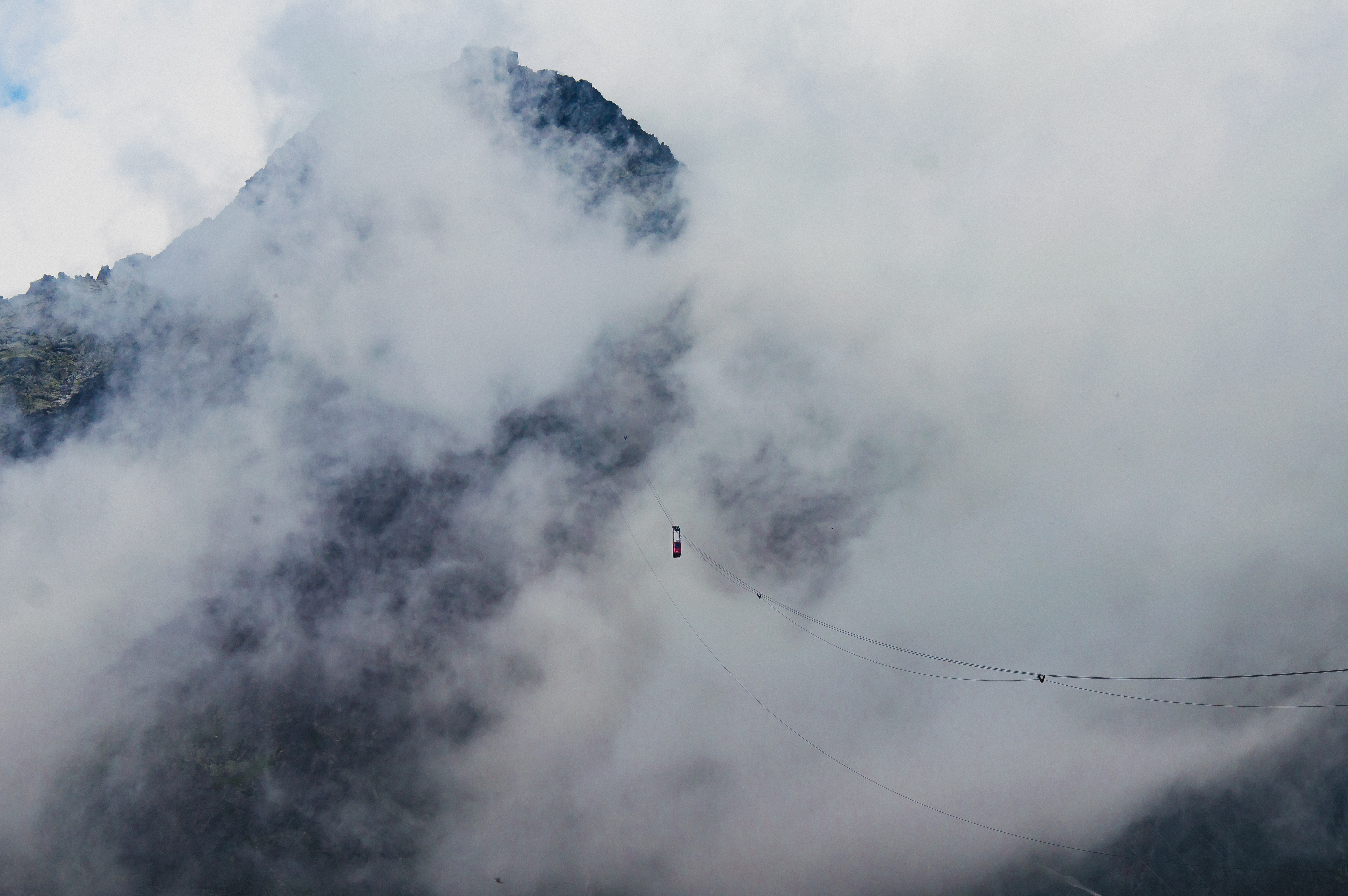 Wires strung through Tatra Mountains on a cloudy, foggy day