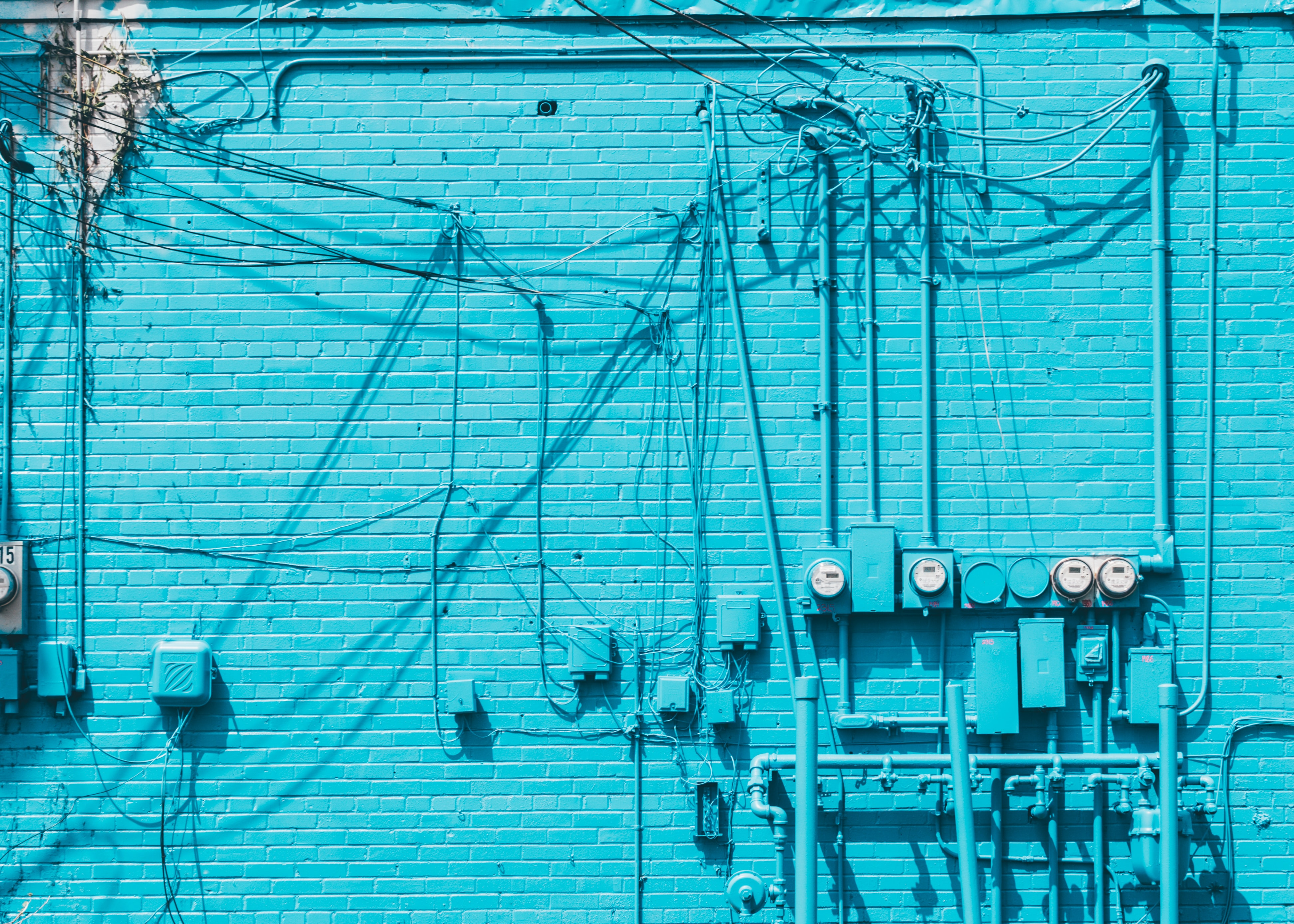 electric meter on blue brick wall