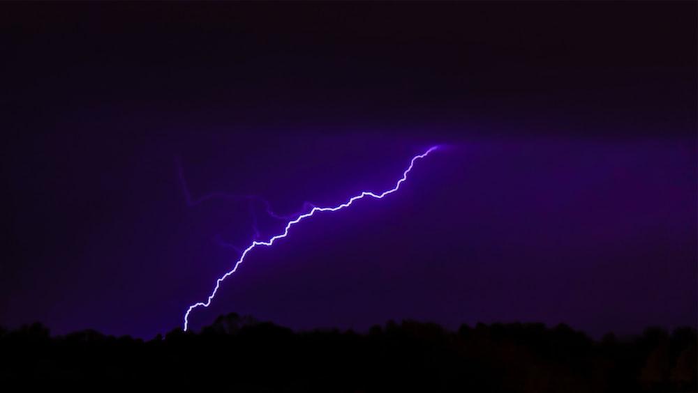 lightning striking mountain
