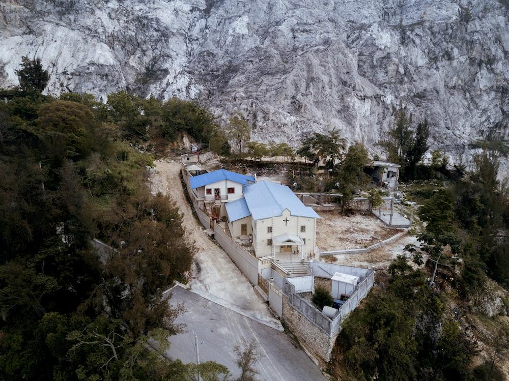 aerial view of church near rock cliff