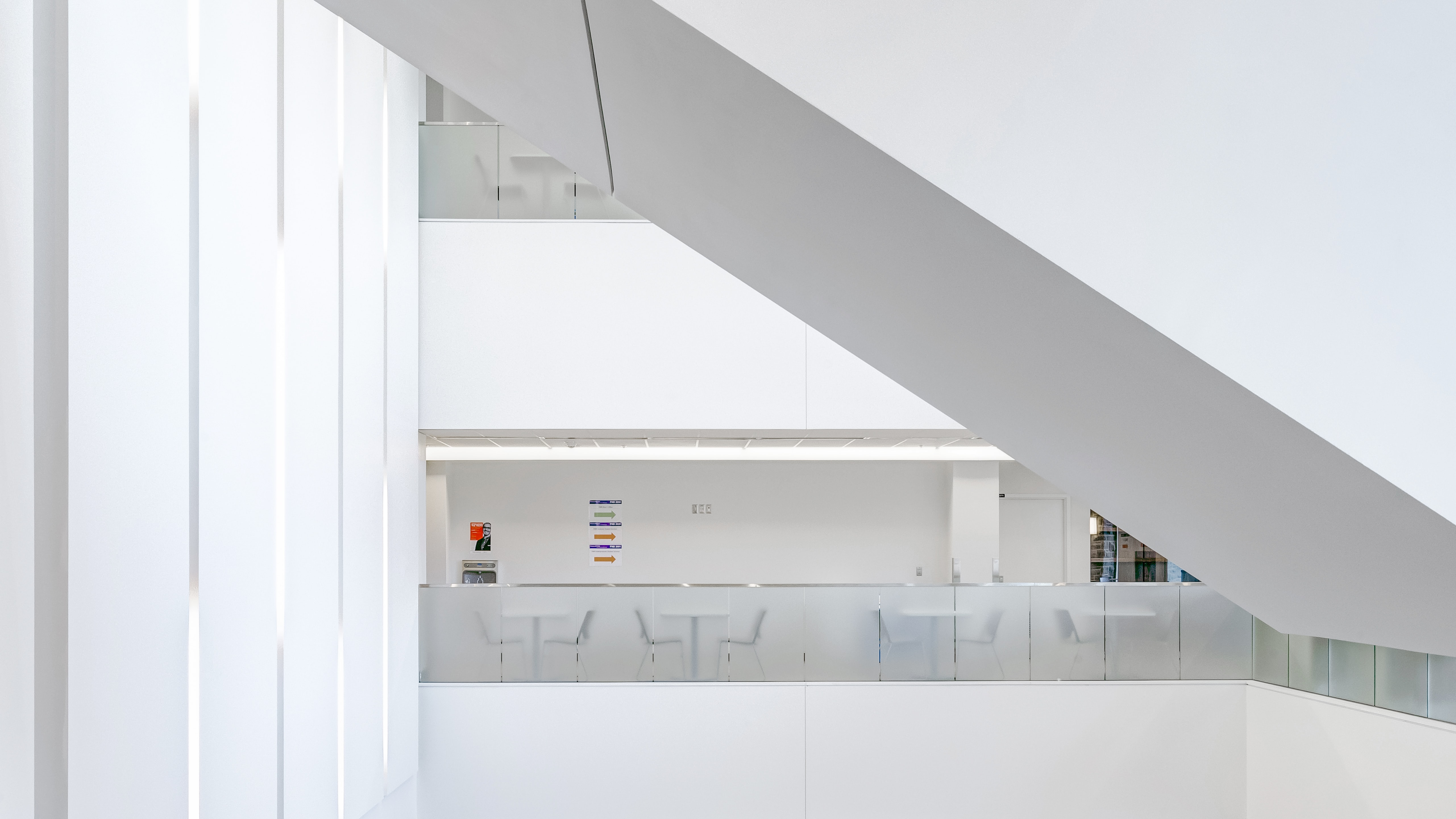 White interior of FIMS Nursing Building with tables and chairs across the room