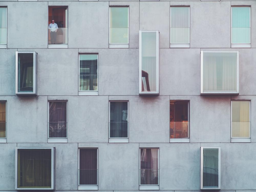 man standing on tenement door