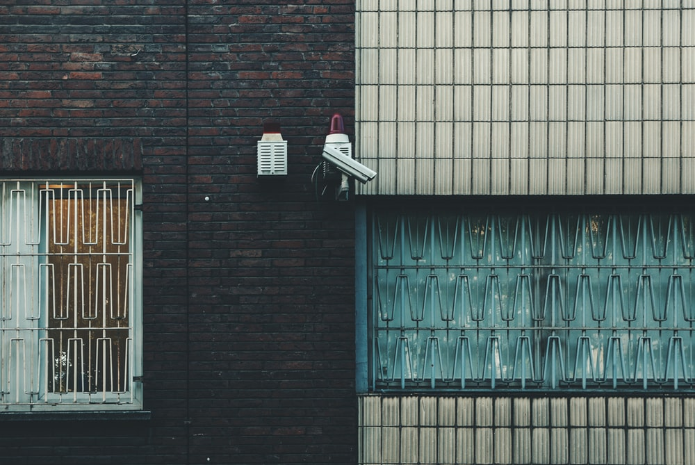 photo of surveillance camera on wallk