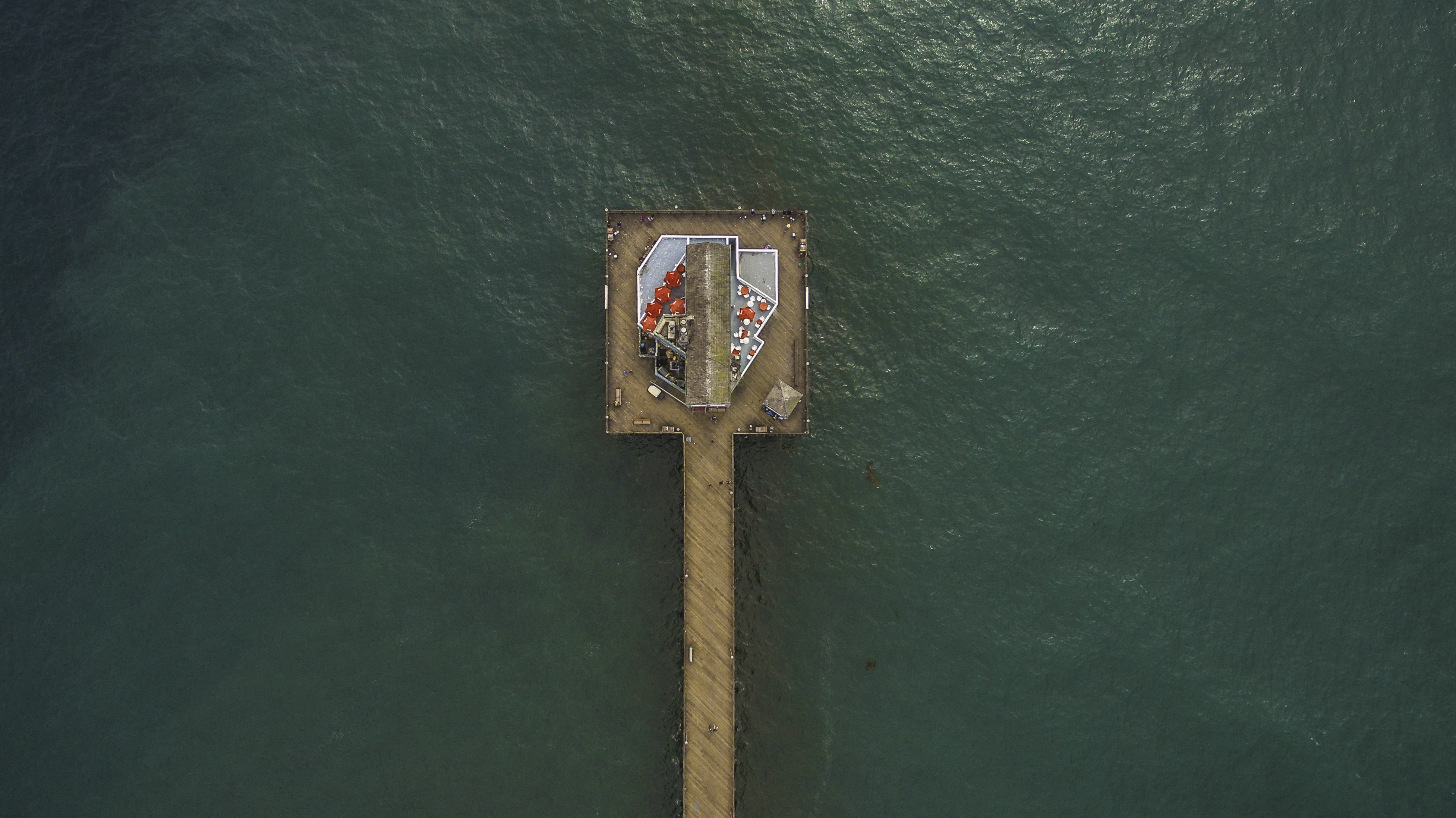 aerial shot photo of brown dock surrounded with body of water