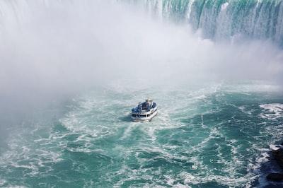 ship on body of water near falls