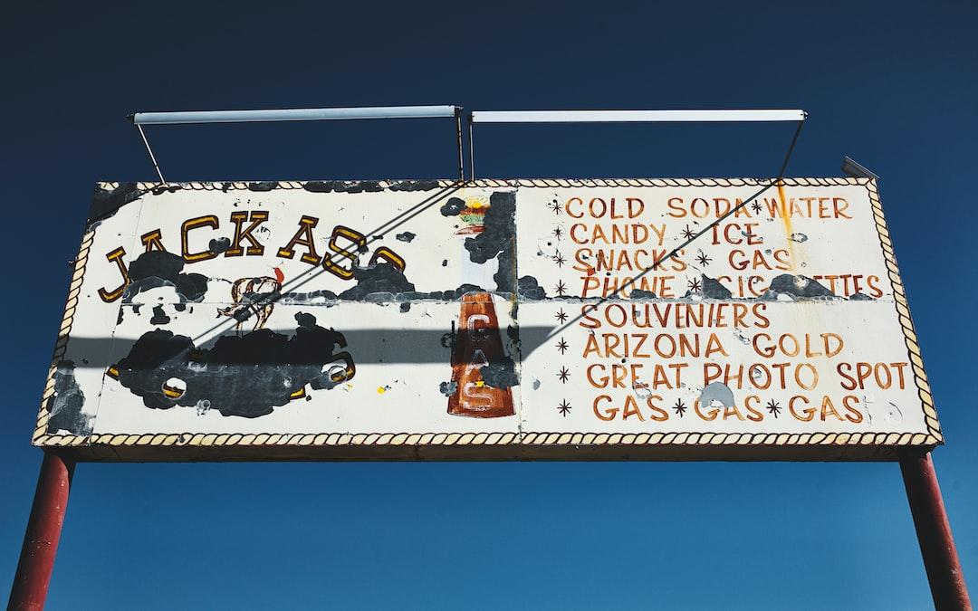 Jackass signboard on road.