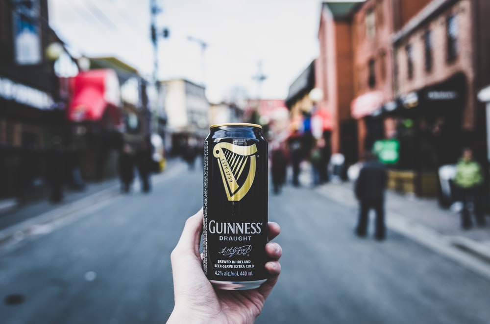 person holding Guinness can