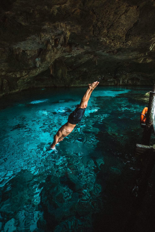 man diving in water