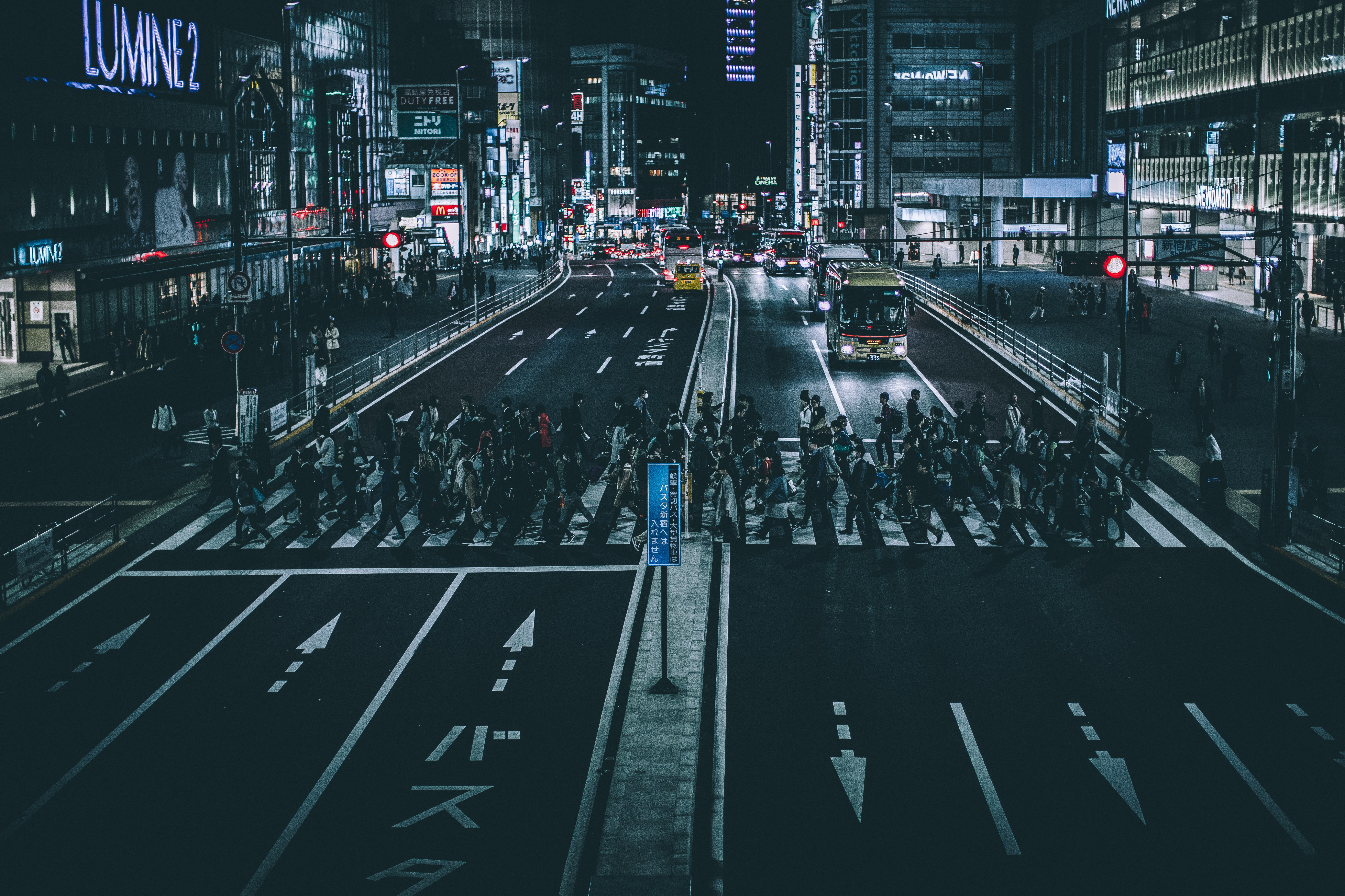 A crowded crosswalk in Tokyo at night