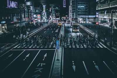 photo of pedestrian during nighttime