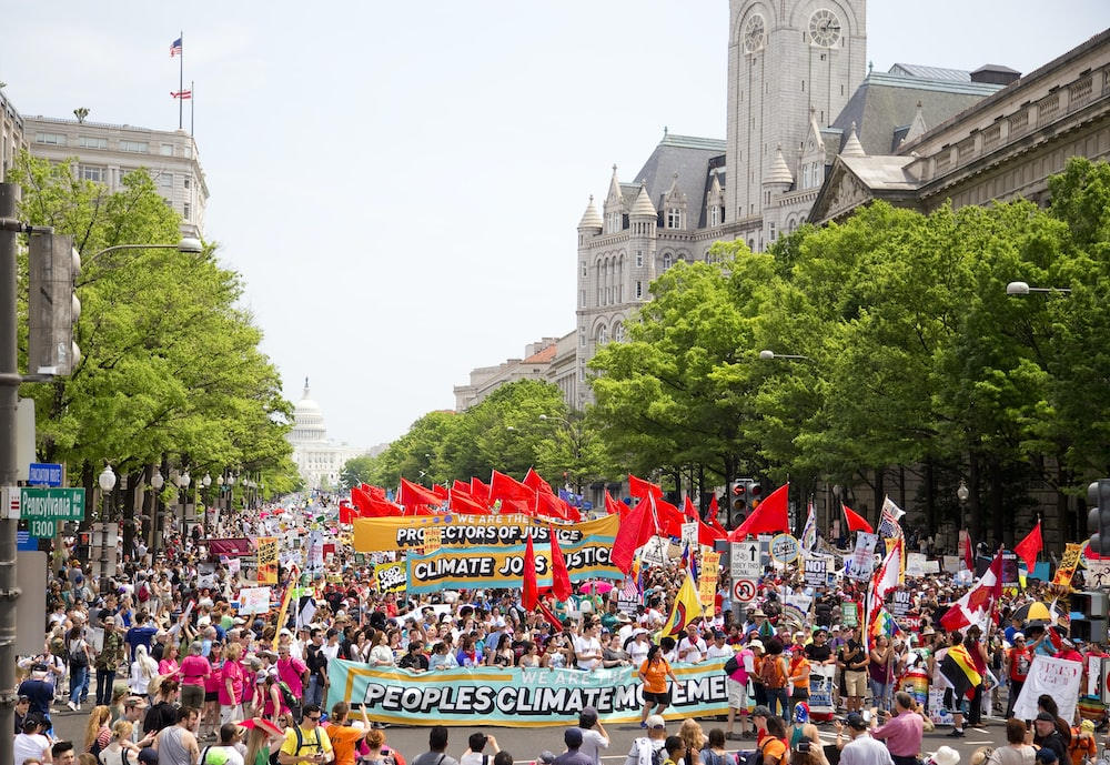People marching for climate control.